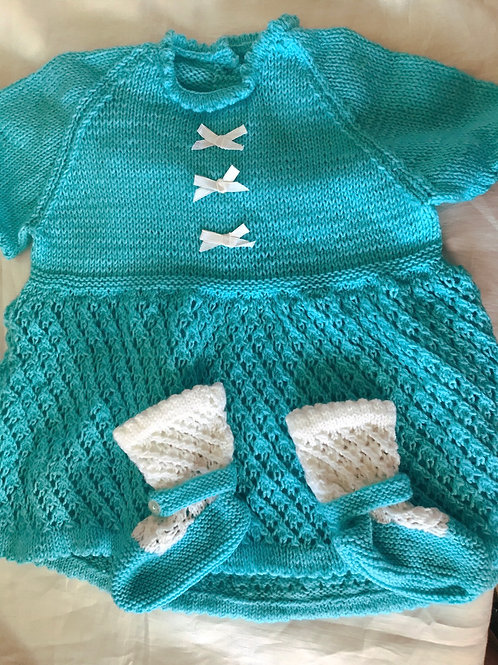 Knitted baby dress and booties
