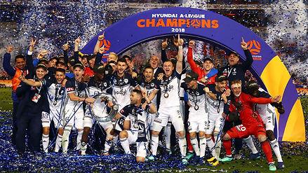 Melbourne Victory celebrate victory duri