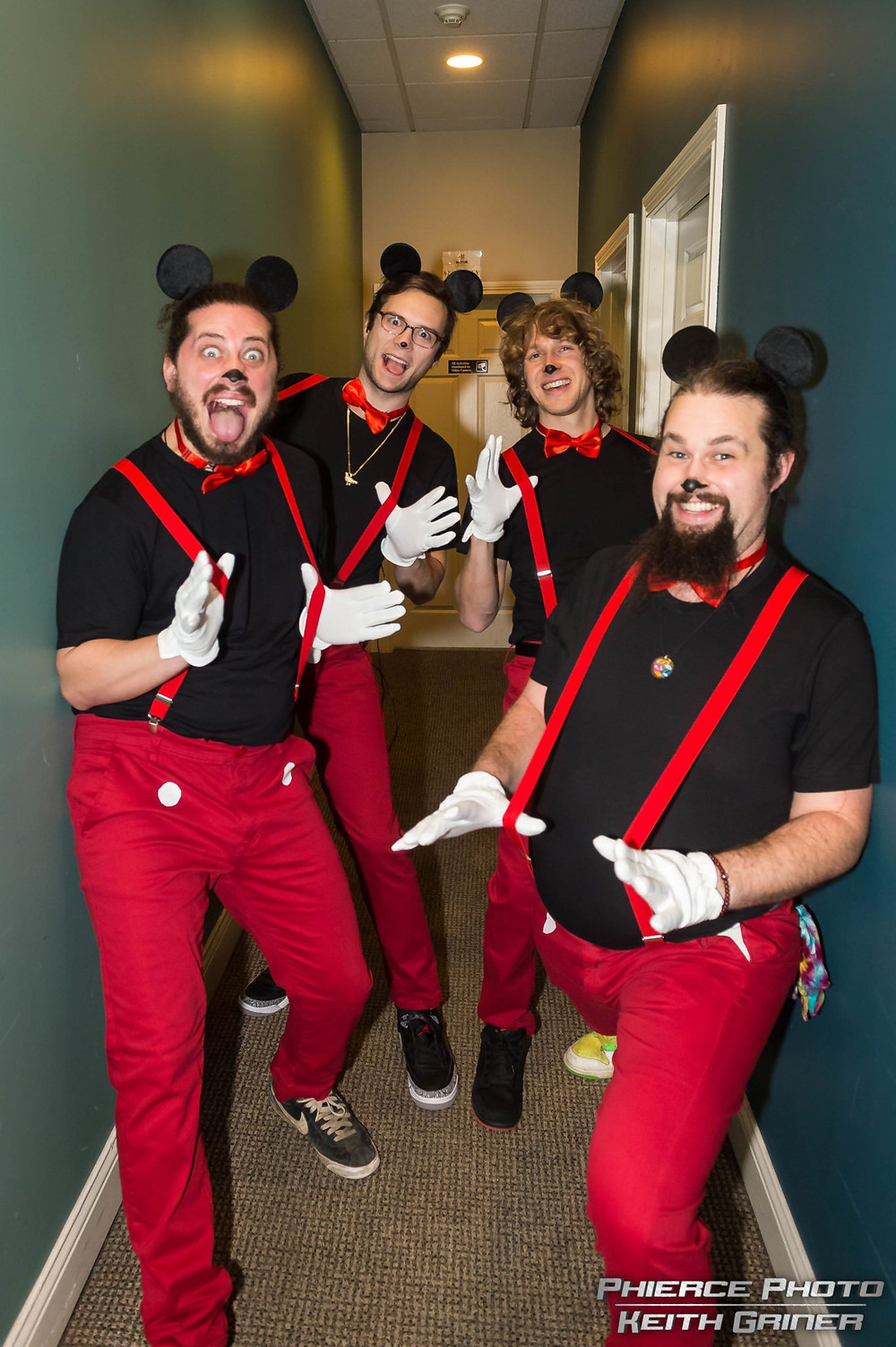 The band dressed in Mickey Mouse attire