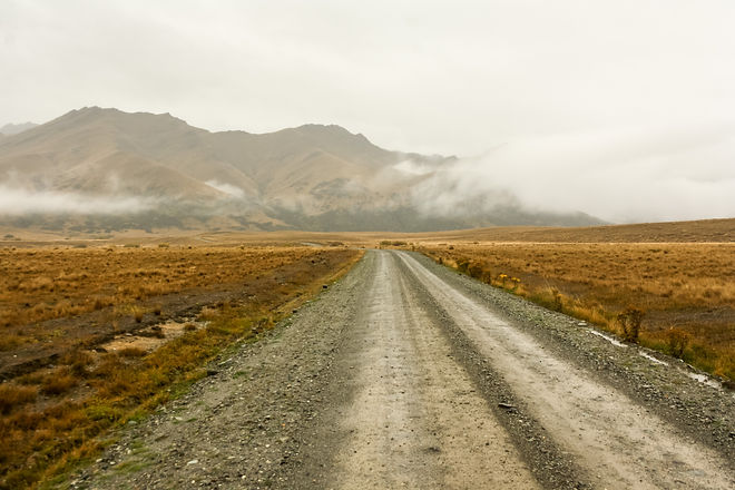 Gravel road and misty weather