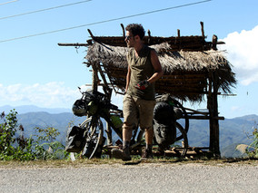Cycling up and down in Laos. Meeting strange ladies of the night and hard days