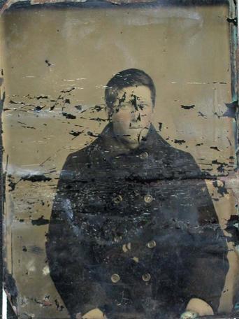 badly damaged tintype image of unidentified subject.