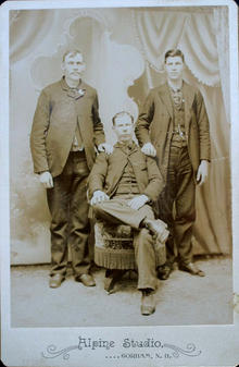 cabinet card of three unidentied male subjecst