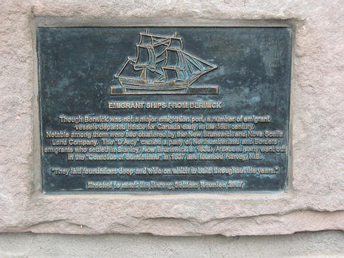 Close up of the commemorative plaque, which reads: