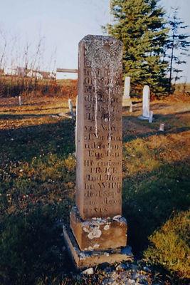 Gravestone (brown sandstone pillar) in Harvey Settlement Cemetery; Section A, Row 9, Plot 99