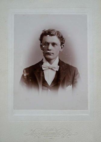 1896 graduation photograph of unidentified male subject