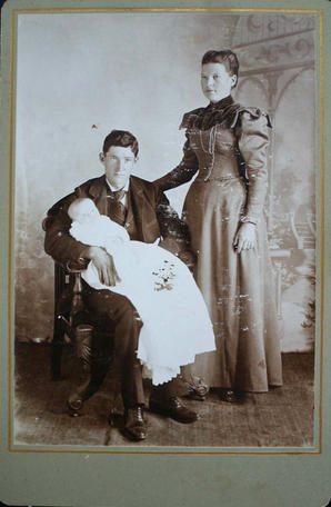 cabinet card of unidentified parents and infan