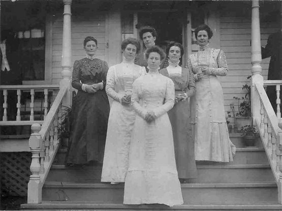 Probable wedding day photograph (30 Jun 1909) of Annie Elizabeth Smith (front and center; b. 20 Jun 1881, d. 13 Jun 1934 of pneumonia at her home in Westbrook, Maine). Married Rev. Roderick Augustus MacDonald. Had two children