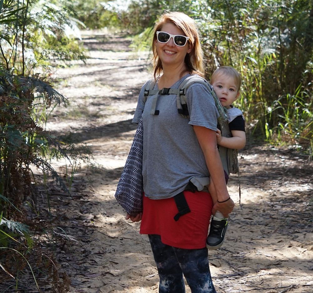 Jade Forder with a baby in an ergo bushwalking