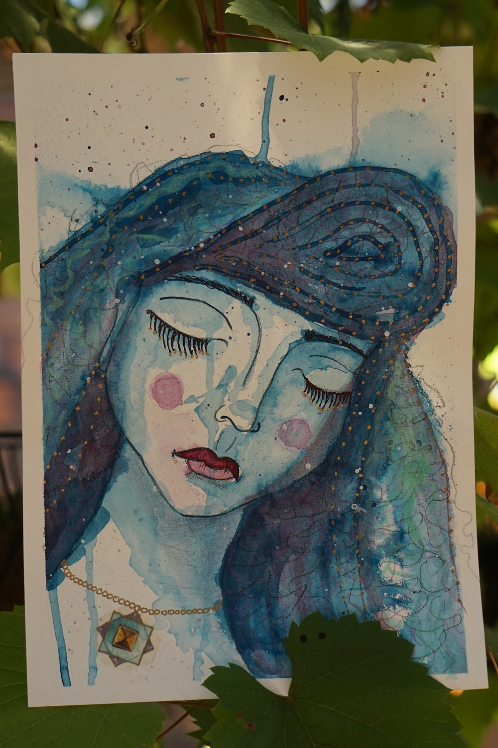 ink painting of a blue woman dreaming