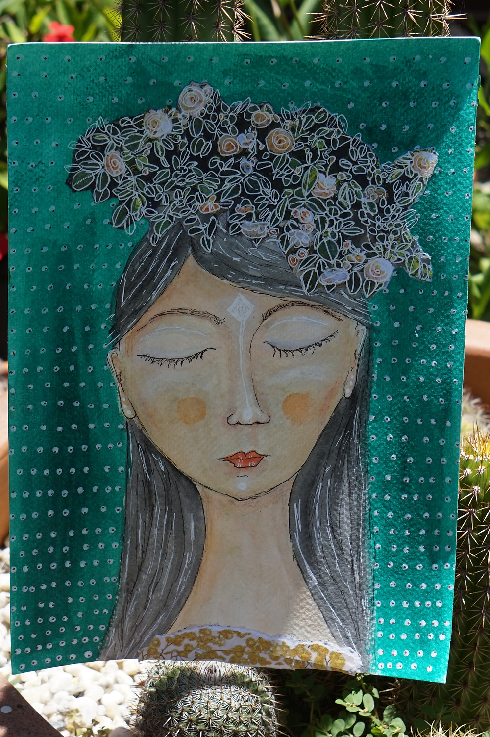 Pensive woman with flowers in her hair and a green background