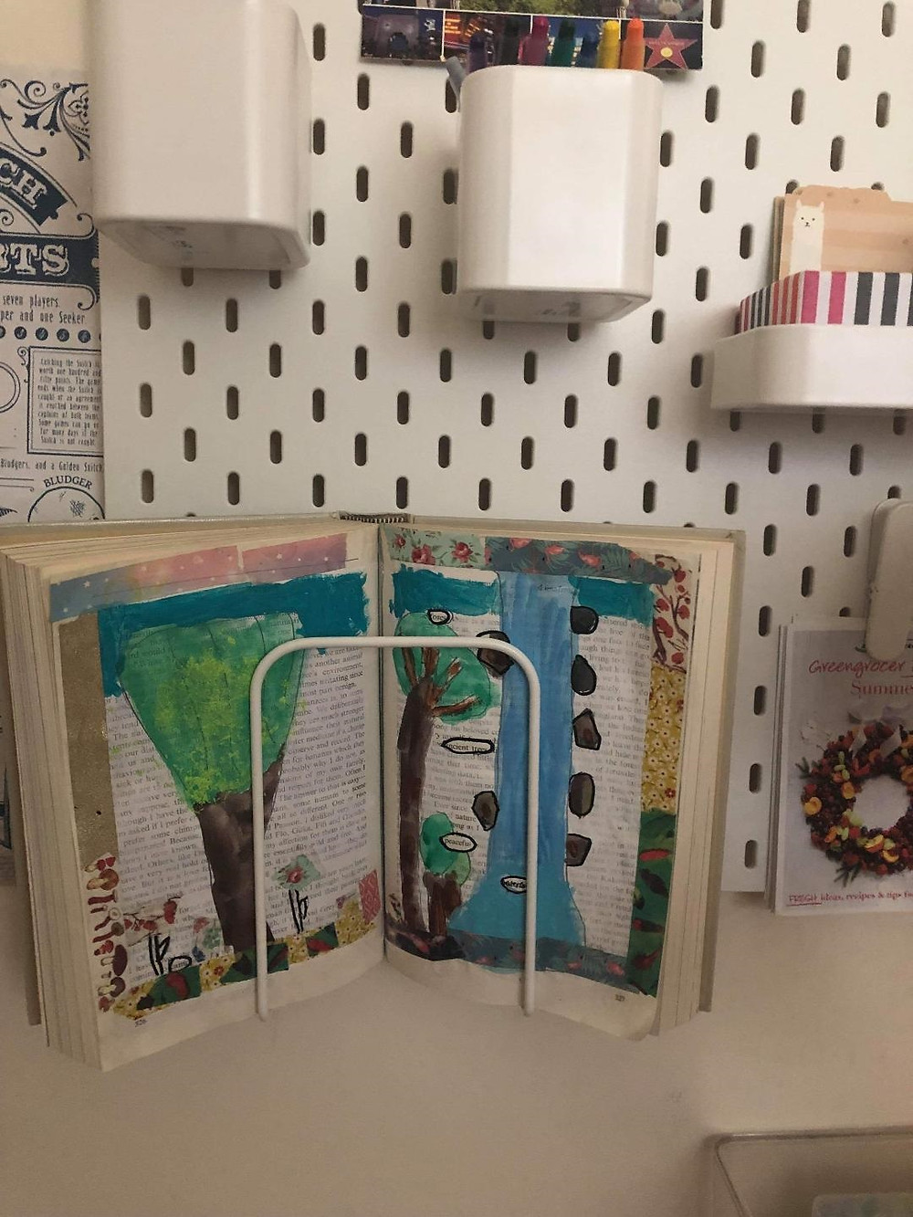altered book on a peg board