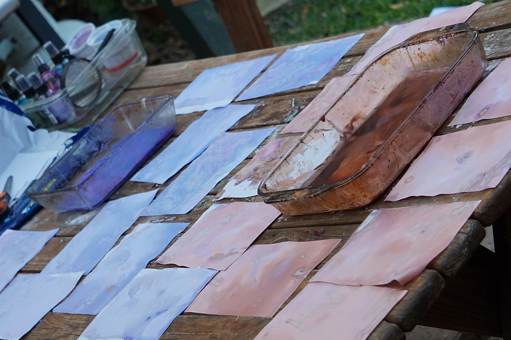 Outdoor wooden table with art and art supplies