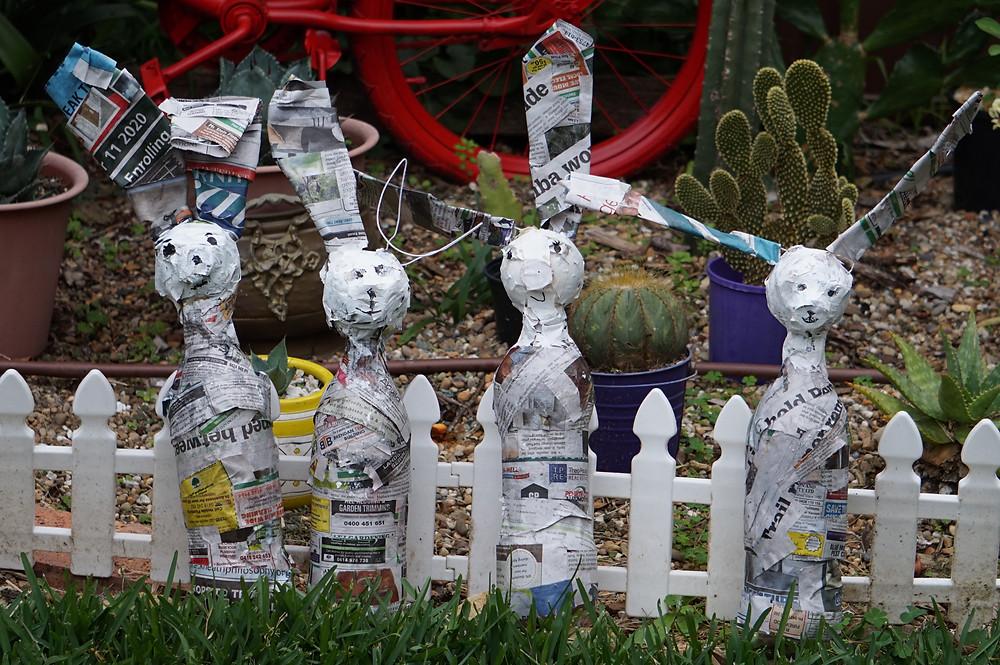 papier mache rabbits in a cacti garden