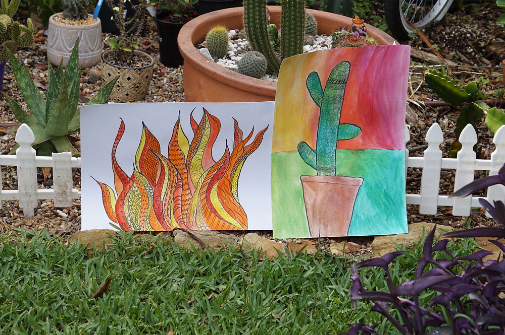 fire painting and cactus painting in a garden