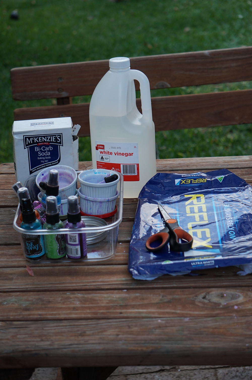 Art supplies on an outdoor wooden table