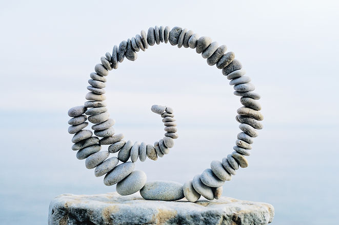 Spiral of pebbles on the top of boulder