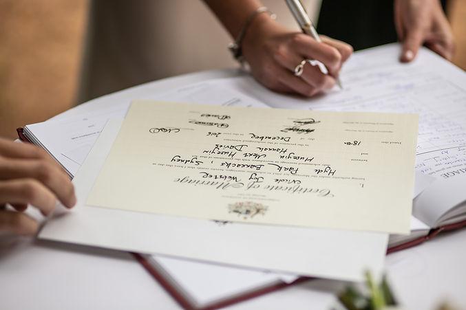 Signing the wedding register at wedding ceremony at Hyde Park Barracks. Wedding photography by best sydney wedding photographer. Grant Hoskinson Photography.