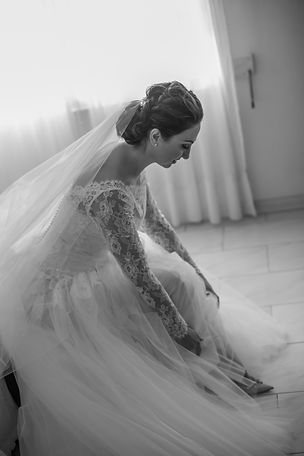 Bride putting her shoes on getting ready. Wedding photography by best sydney wedding photographer, Grant Hoskinson Photography.