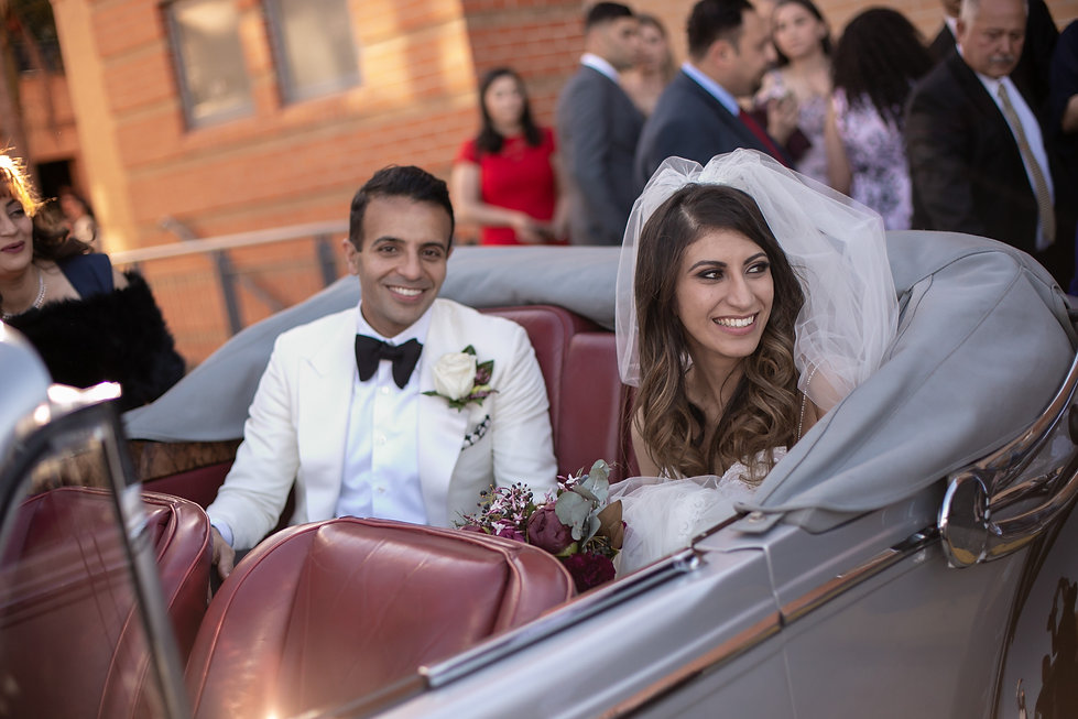 Bride and groom in the wedding car after the ceremony.  St Mary and St Merkorious Coptic Orthodox church. Photography by best Sydney wedding photographer Grant Hoskinson Photography.