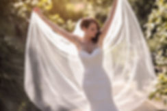 Beautiful bride showing the veil in the botanic gardens, Melbourne. Beautiful wedding photography by popular Sydney wedding photographer, Grant Hoskinson Photography.