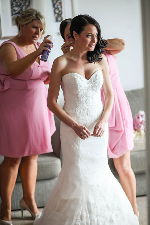 Beautiful wedding photography by popular wedding photographer, Grant Hoskinson Photography. Bride getting ready with bridesmaids.