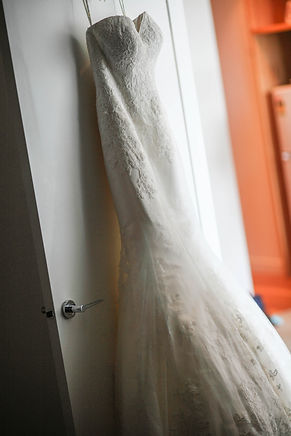 Beautiful wedding photography by popular wedding photographer, Grant Hoskinson Photography. Wedding dress hanging up. Melbourne wedding.