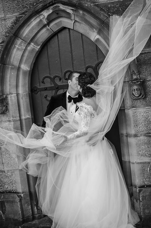Bride's veil in the wind. Greek wedding ceremony at the Cathedral of the Annunciation of Our Lady Greek church, Redfern, Sydney. Wedding photography by best sydney wedding photographer, Grant Hoskinson Photography.