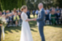 Bride and groom during the outdoor wedding ceremony at Gibraltar Hotel, Bowral. Wedding photography by best sydney wedding photographer, Grant Hoskinson Photography.
