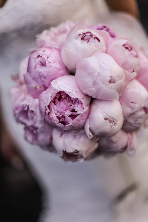 Bride's wedding bouquet. Peonies. Beautiful wedding photography by popular wedding photographer, Grant Hoskinson Photography.