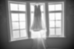 Sydney wedding photographer. Grant Hoskinson Photography. Wedding dress hanging in the window at Sugar Beach Events, Maui, Hawaii. Dress by Berta Bridal.
