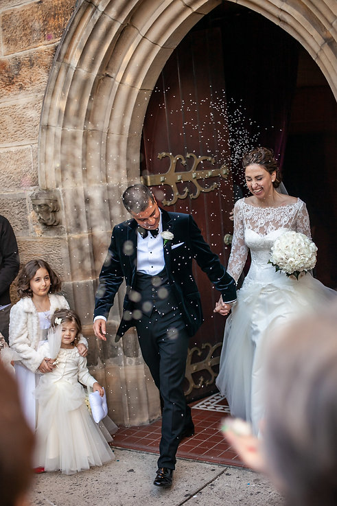 Throwing rice at the Greek wedding ceremony at the Cathedral of the Annunciation of Our Lady Greek church, Redfern, Sydney. Wedding photography by best sydney wedding photographer, Grant Hoskinson Photography.