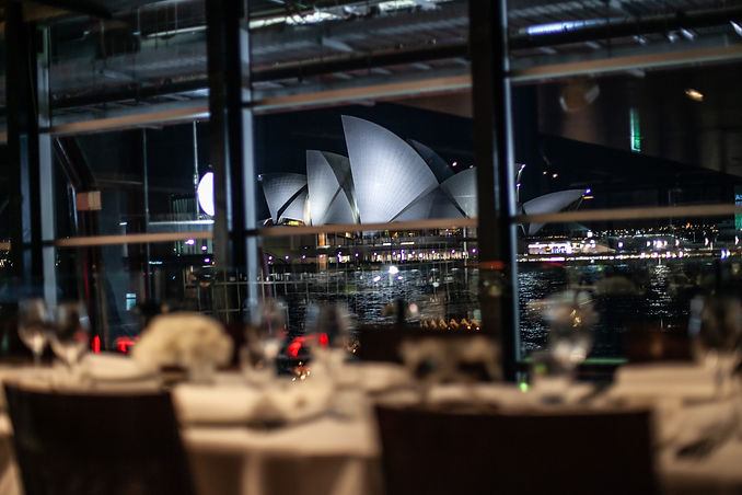 View of the Sydney Opera House from the wedding reception venue at Quay Restaurant. Wedding photography by best sydney wedding photographer, Grant Hoskinson Photography.