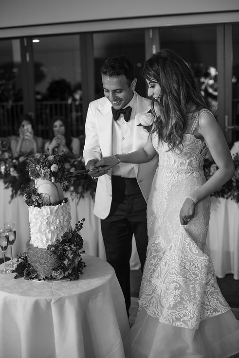 Cutting the cake. Wedding reception at Sergeants Mess. Photography by best Sydney wedding photographer Grant Hoskinson Photography.