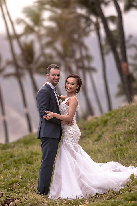 Bride and Groom Portrait with the palm trees outside Sugar Beach Events, Maui, Hawaii. Destination wedding photography by Grant Hoskinson Photography.