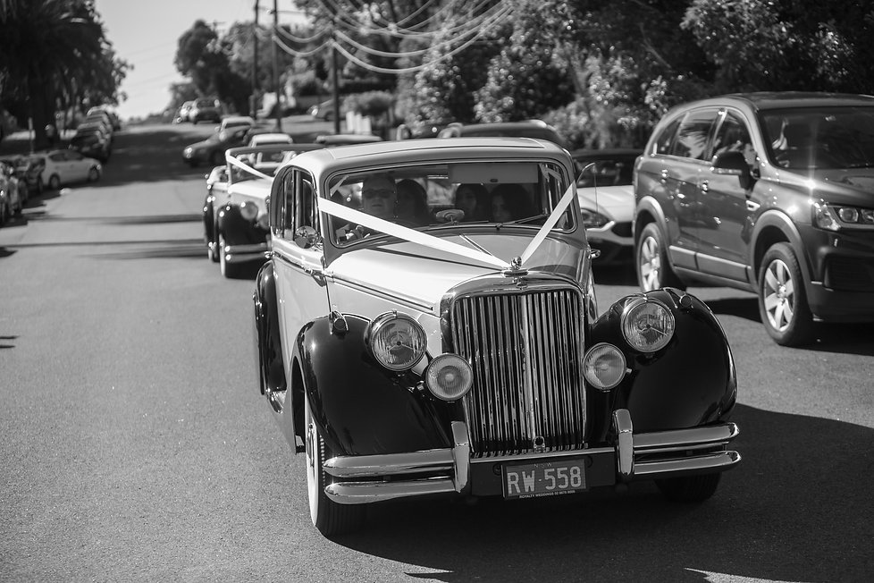 Wedding cars arriving at the church. Photography by best Sydney wedding photographer Grant Hoskinson Photography.