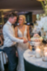 Cutting the wedding cake. Wedding reception. Catalina Rose Bay.