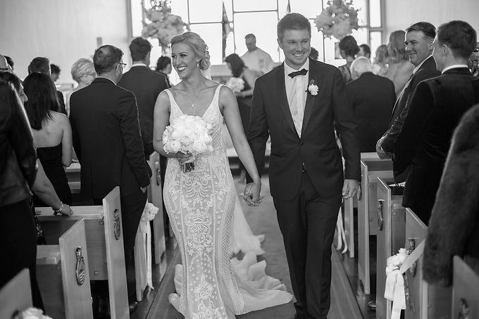 Walking back down the aisle. Bride and groom at the wedding ceremony at HMAS Watson Chapel. Wedding photography by best Sydney wedding photographer, Grant Hoskinson Photography.