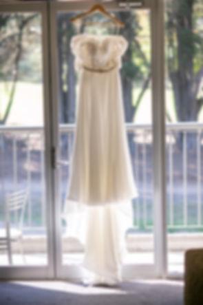 Wedding dress hanging at Gibraltar Hotel, Bowral. Wedding photography by best sydney wedding photographer, Grant Hoskinson Photography.