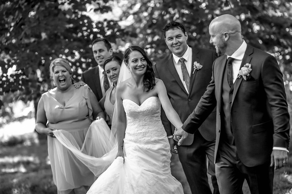 Bridal party walking in the botanic gardens, Melbourne. Beautiful wedding photography by popular Sydney wedding photographer, Grant Hoskinson Photography.