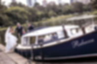 Beautiful wedding photography by popular Sydney wedding photographer, Grant Hoskinson Photography. Bride and groom travelling by boat to the wedding reception.