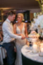 Bride and groom cutting cake at the wedding reception venue at Catalina, Rose Bay. Wedding photography by best sydney wedding photographer, Grant Hoskinson Photography.