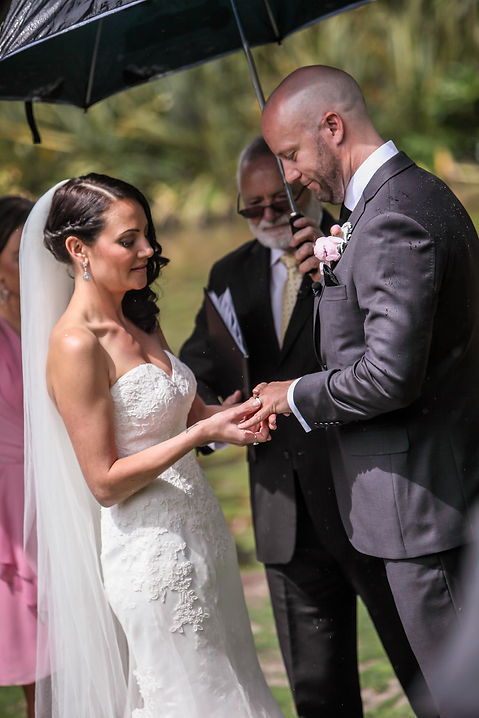 Beautiful wedding photography by popular wedding photographer, Grant Hoskinson Photography. Exchange of rings. Wedding photography.Groom with groomsmen.  Royal Botanic Gardens, Melbourne.