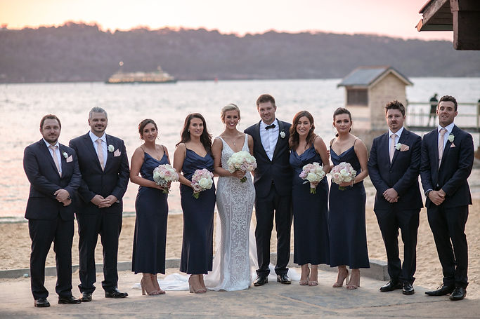 Bride and groom and bridal party on location photos at Camp Cove, Sydney Harbour. Wedding photography by best sydney wedding photographer, Grant Hoskinson Photography.