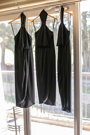 Brides maids dresses hanging at Gibraltar Hotel, Bowral. Wedding photography by best sydney wedding photographer, Grant Hoskinson Photography.