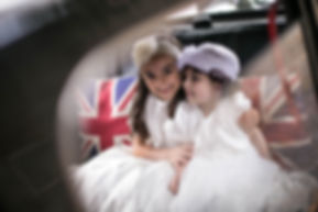 Flower girls in the back of the bridal cars. Wedding photgraphy by Sydney wedding photographer Grant Hoskinson Photography.