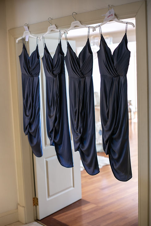 Bridesmaids dresses hanging. Photography by best Sydney wedding photographer Grant Hoskinson Photography.