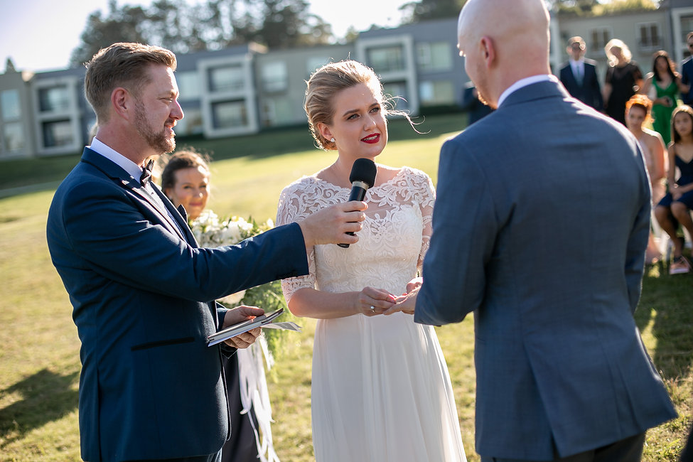 Ring exchange at outdoor wedding ceremony at Gibraltar Hotel, Bowral. Wedding photography by best sydney wedding photographer, Grant Hoskinson Photography.
