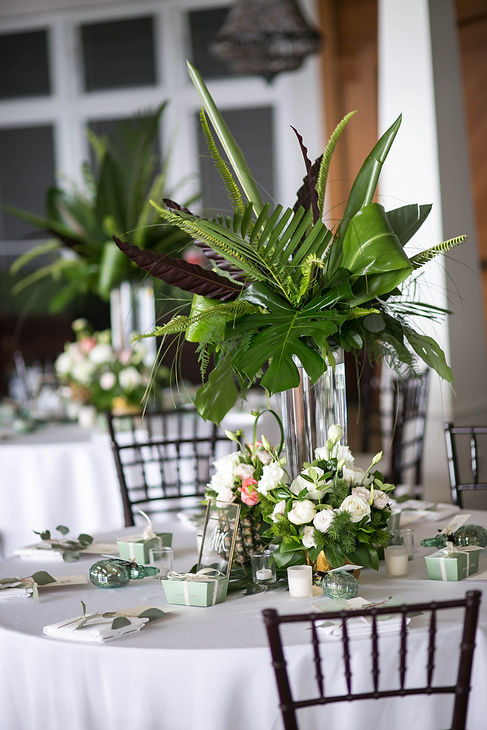 Table centre pieces.Wedding reception. Sugar Beach Events. Maui, Hawaii.