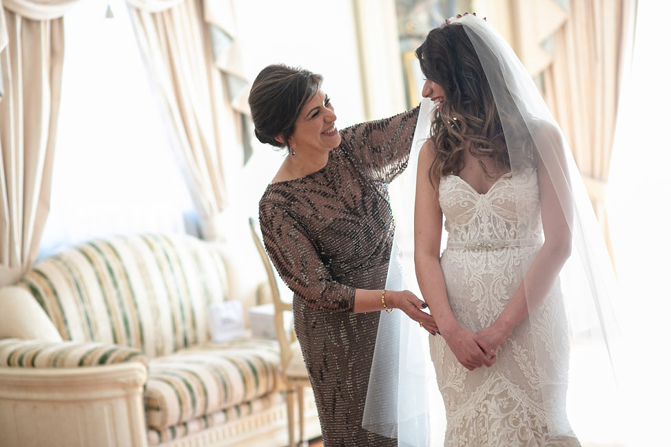 Mother of the bride putting the bride's veil on. Photography by best Sydney wedding photographer Grant Hoskinson Photography.